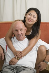 Western Men And Young Thai Women